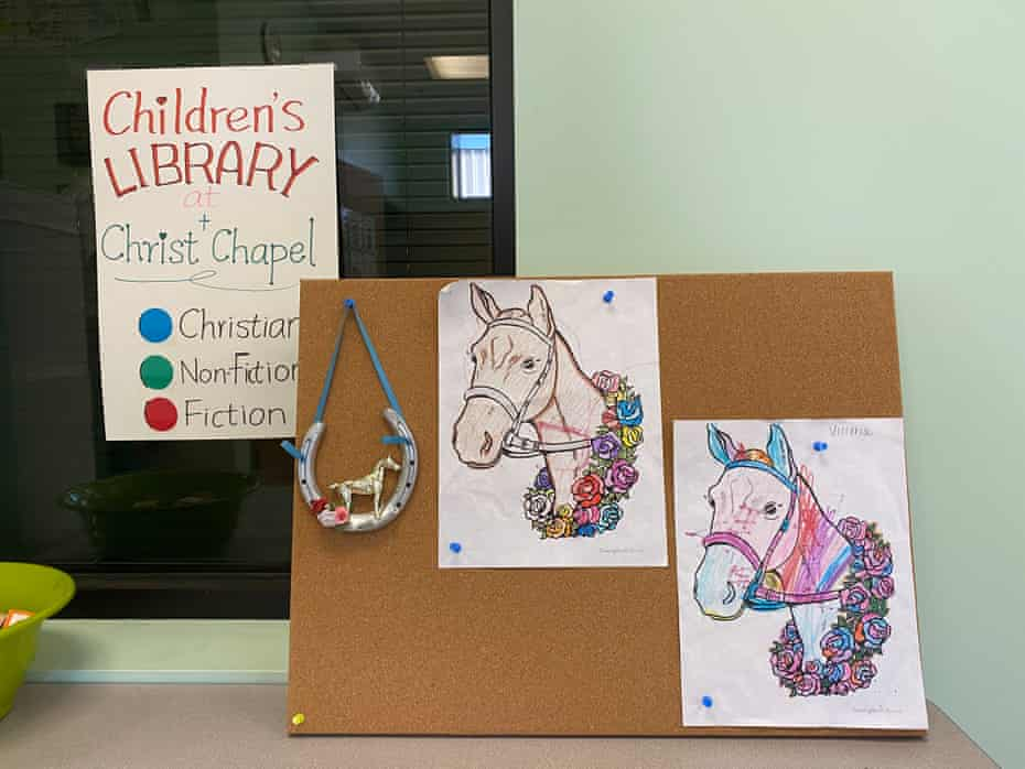Pictures of horses colored by children inside a children's library at the Christ chapel on the Backside of Churchill Downs.