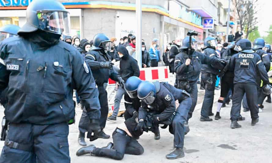 Police detain protesters during the 'Revolutionary May Day' demonstration in Berlin's Kreuzberg district.