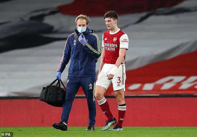 Left-back Kieran Tierney (right) has been a long-term casualty with knee ligament damage