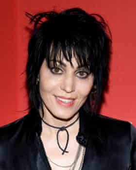 Photograph of Joan Jett with her distinctive shoulder length shaggy black hair with long fringe