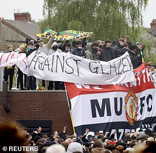 Thousands of Manchester United fans gathered at Old Trafford in protest against the American billionaires who own the club,