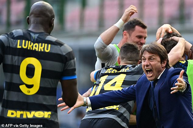 The striker's 61 goals in just 92 games have made him a key part of Antonio Conte's (right) side