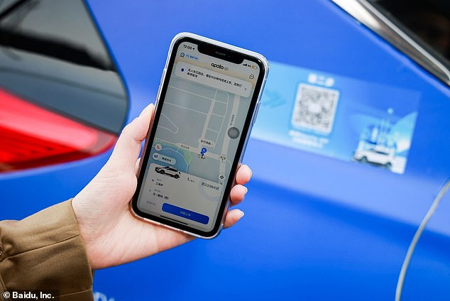 Users hail a cab by selecting it on the Apollo Go app. The doors are unlocked by scanning a QR code and health information
