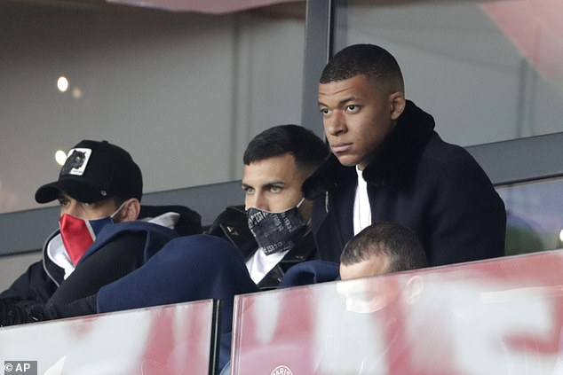 Mbappe (right)has been struggling with a calf injury and only returned to individual training