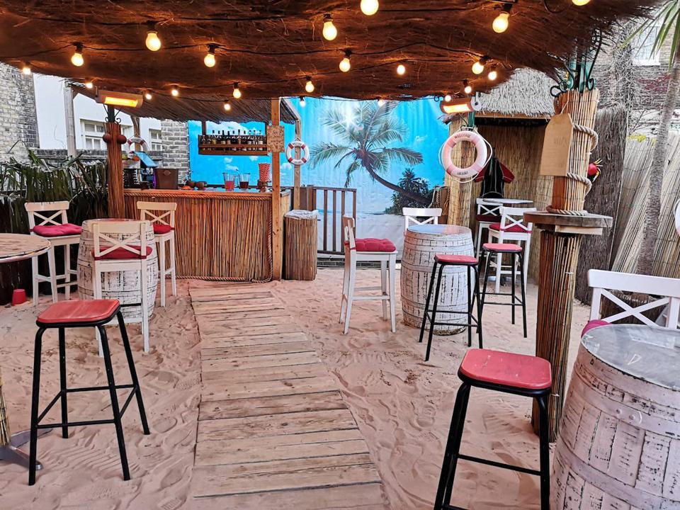 beach bar with sandy floor