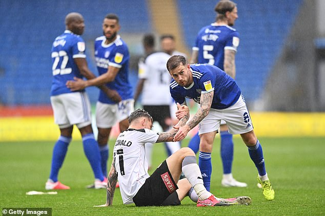 Joe Ralls consoles Rotherham's Angus MacDonald moments after the final whistle