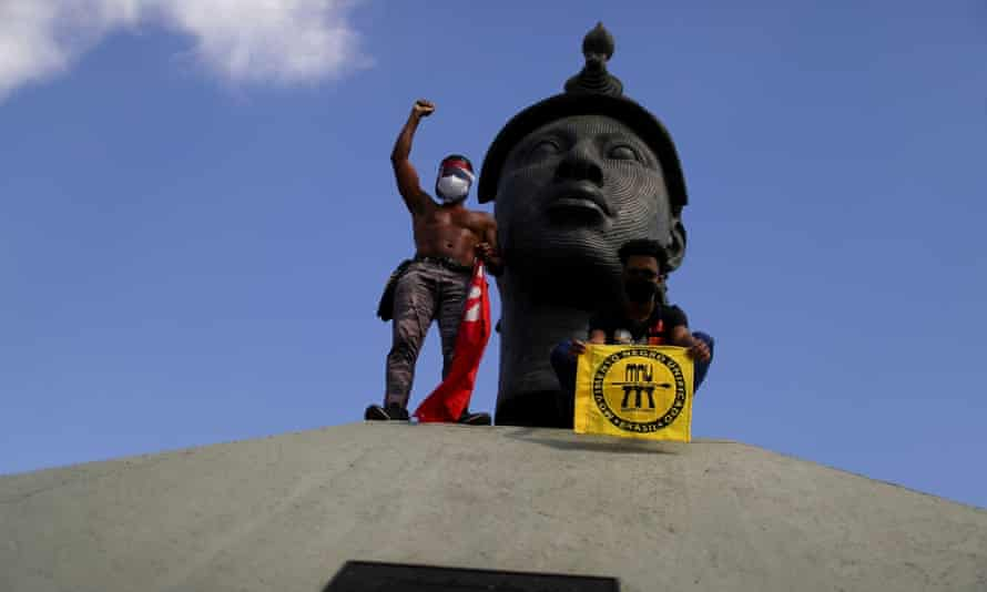 Demonstrators protest against Jair Bolsonaro in front of Monumento Zumbi in Rio de Janeiro