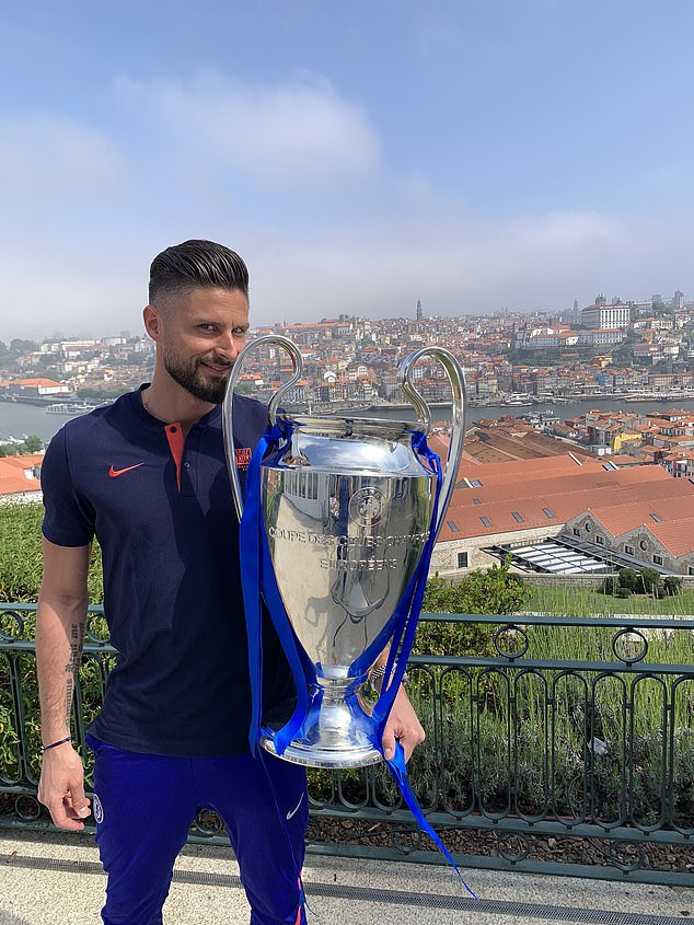 Giroud was pictured with the Champions League trophy after overcoming City on Saturday