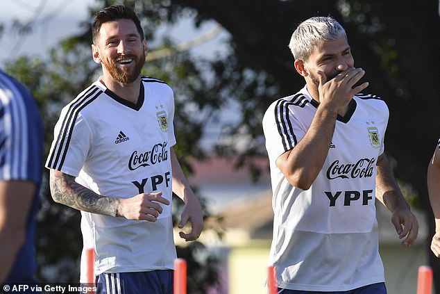 Aguero is widely expected to join Barcelona and link up with close friend Lionel Messi (left)