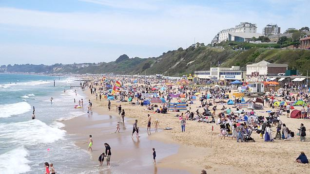 People flock to Bournemouth beach over the bank holiday weekend