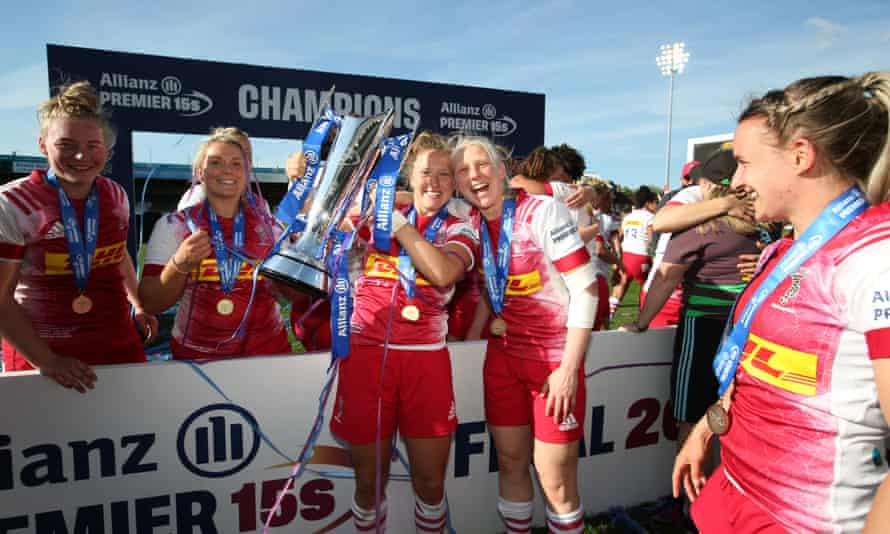 Emily Scott (left) and Heather Cowell of Harlequins with the Premier 15s trophy.