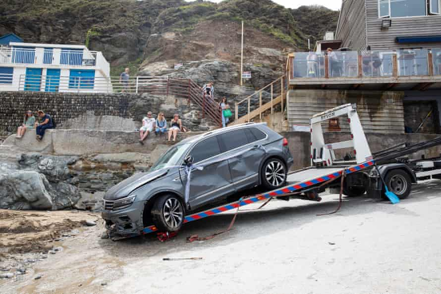 The car being dragged onto a recovery trailer.