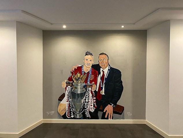 Former Manchester United defender Alexander Buttner showed off a bizarre mural in his home