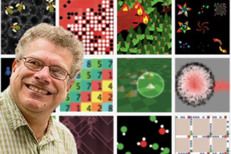 Professor Uri Wilensky with NetLogo model images in the backdrop