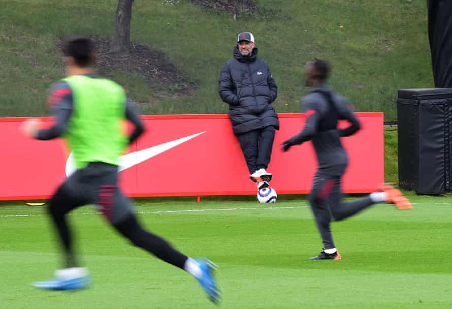 Jürgen Klopp takes in a Liverpool training session.