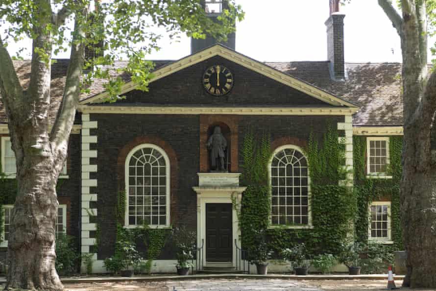 The statue of Robert Geffrye above the central door of the building's 18th-century facade.