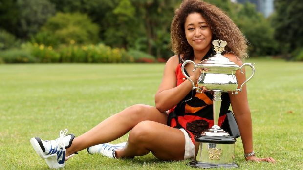 Naomi Osaka of Japan poses with the Daphne Akhurst Memorial trophy after winning the 2021 Australian Open. Photograph: Graham Denholm/Getty Images