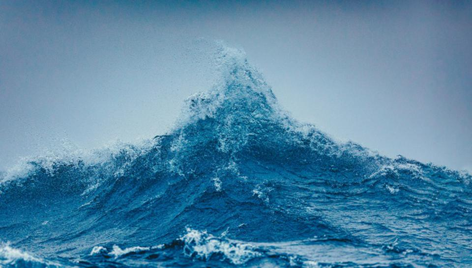 Two large swells meet and create a large peak of powerful ocean