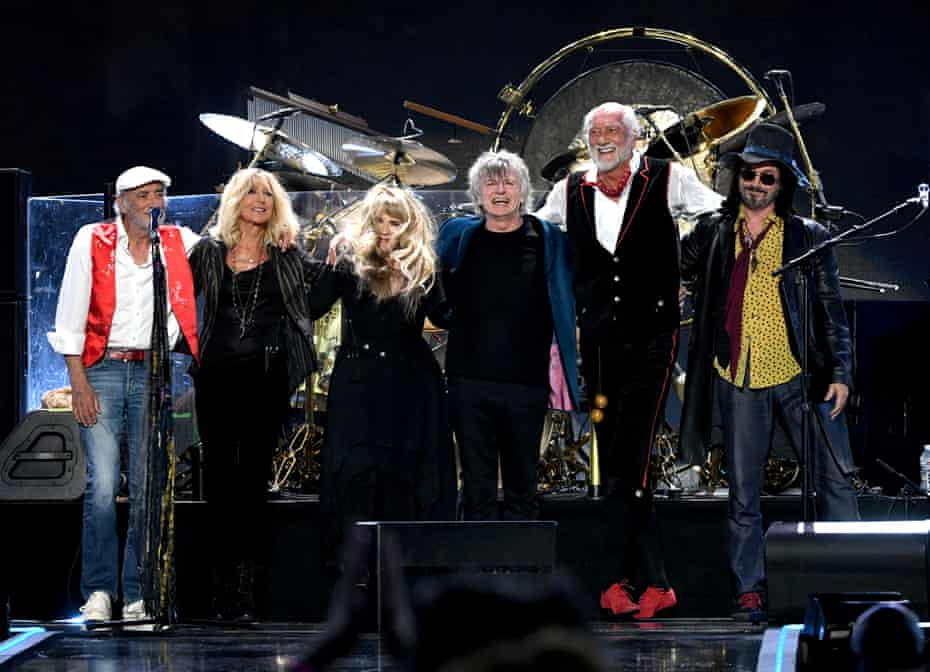 Neil Finn (centre right) flanked by  John McVie, Christine McVie, Stevie Nicks, Mick Fleetwood, and Mike Campbell of Fleetwood Mac.