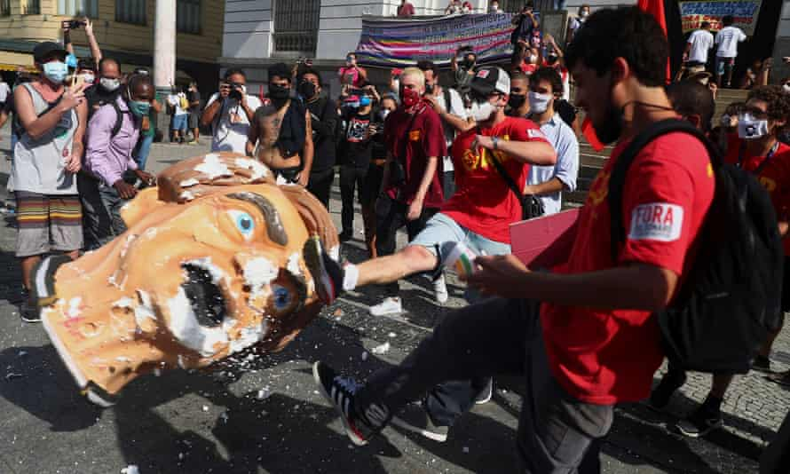 Demonstrators kick a head prop depicting Brazil's president,Jair Bolsonaro, during a protest in Rio de Janeiro on Saturday.