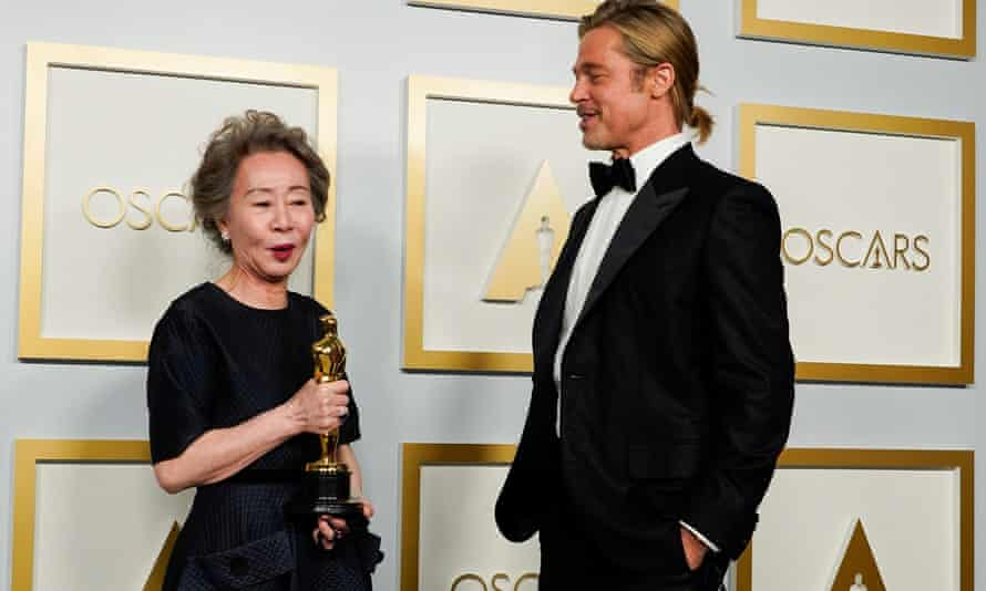 Brad Pitt poses with Yuh-Jung Youn and his tiny ponytail at the Oscars.