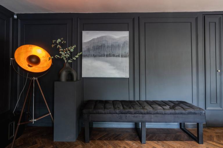 almost black house - large light with velvet bench