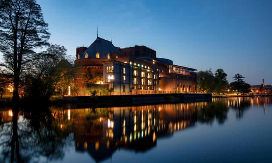 Royal Shakespeare Theatre reflecting in the River Avon at dusk. Stratford Upon Avon, Warwickshire, UK.