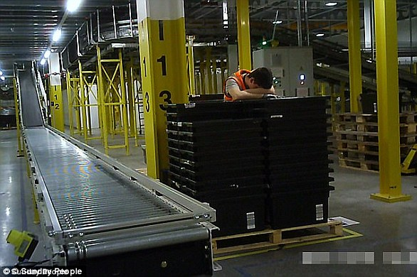 Staff at one of the delivery giant's warehouse were photographed sleeping on the job in Tilbury, Essex (pictured)