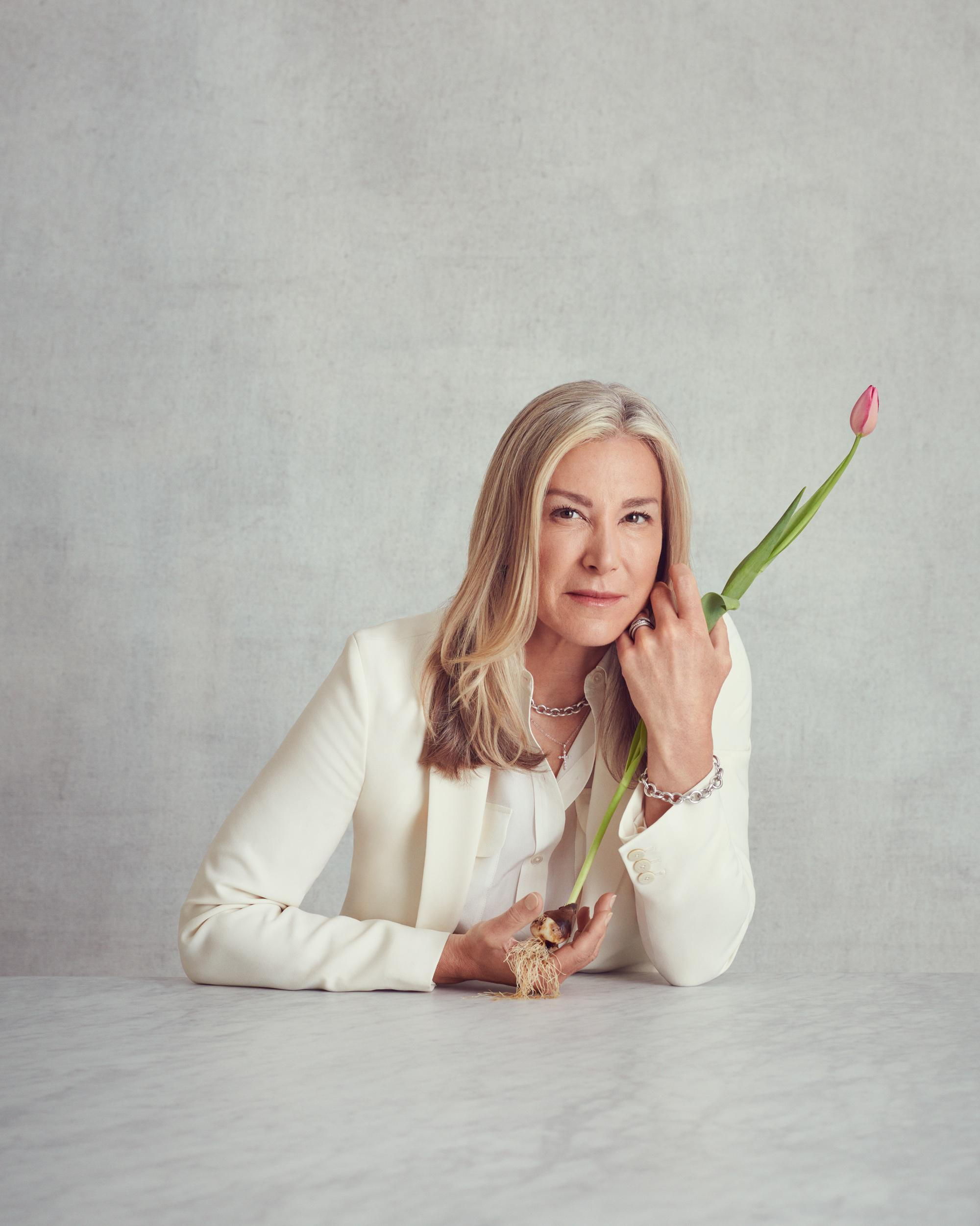 Cutting-edge venture capital investor Tracy Caldwell holds a single tulip – the bulb and roots defiant.