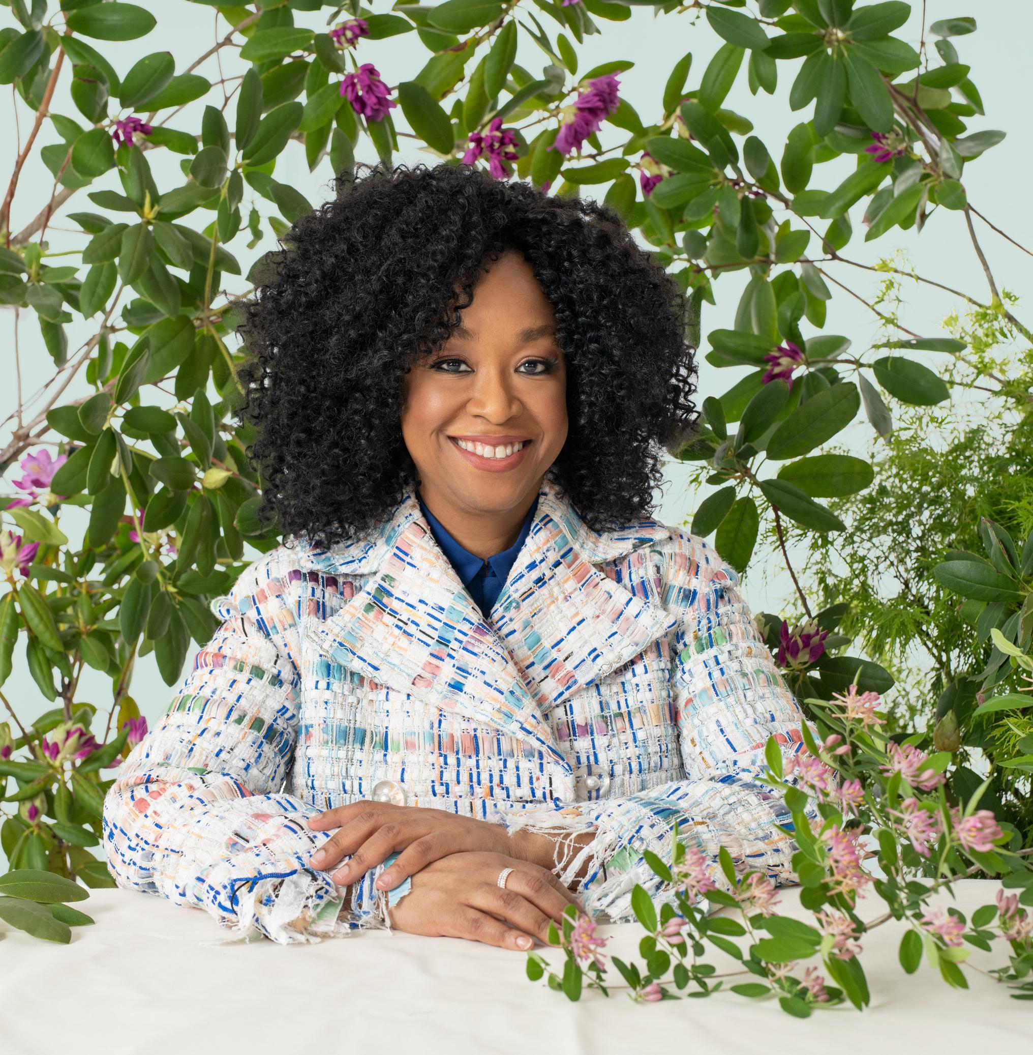 Shonda Rhimes, creator of Bridgerton, Grey's Anatomy and more, emerges from unopened fists of Rhododendron – like her many as yet untold stories.