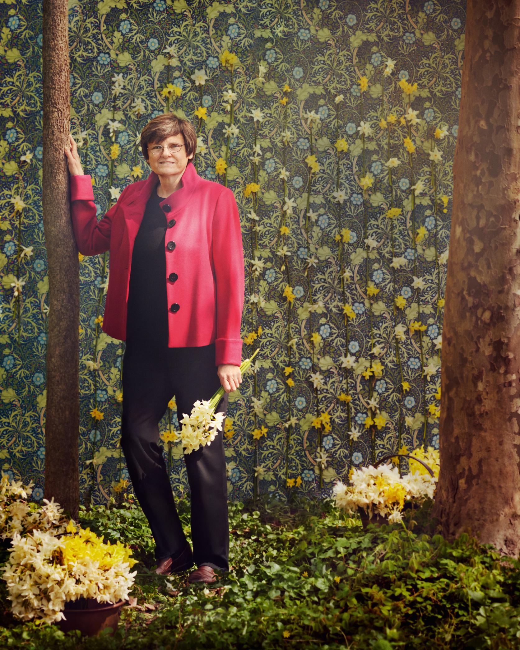 Dr. Kati Kariko, whose pioneering research of mRNA-based therapy, used to develop the Pfizer and Moderna Covid vaccines, is amidst by a shock of white tulips from her native Hungary.
