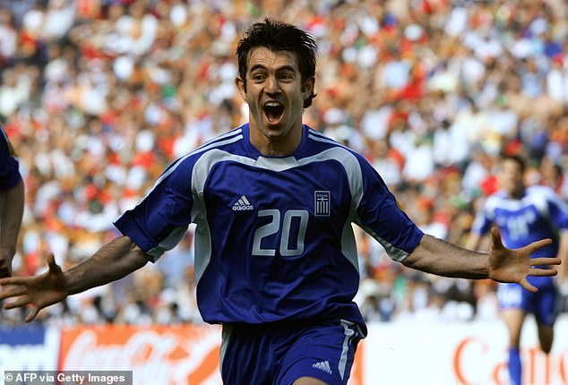 Karagounis celebrates his goal which saw Greece win 2-1 and set the tone for the competition