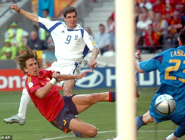 Angelos Charisteas then helped Greece grab a draw with Spain on their way to the last eight