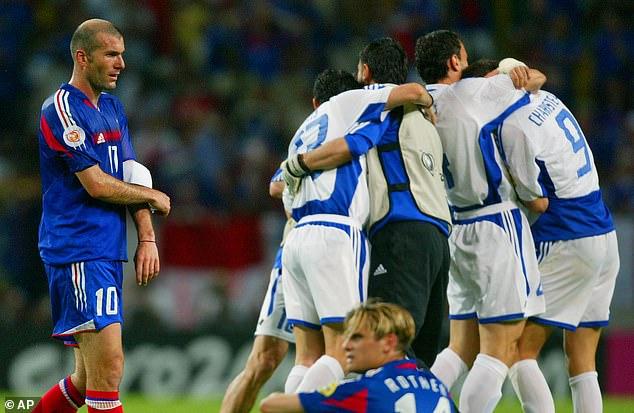 Zinedine Zidane walks off dejected as Greece stars celebrate beating the tournament holders