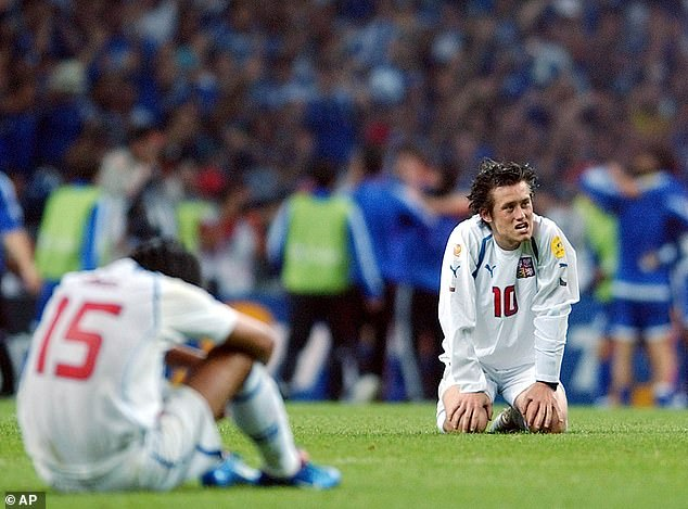 Czech Republic's Tomas Rosicky drops to his knees in despair after seeing his side eliminated