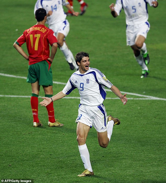 The Greek forward runs off to celebrate his goal which proved to be the winner in Lisbon