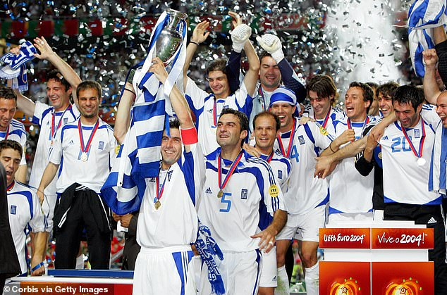 Theo Zagorakis lifts the trophy to officially crown Greece as shock winners of Euro 2004