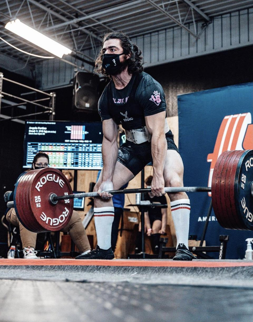 A man performs a deadlift wearing Notorious Lifts shoes.