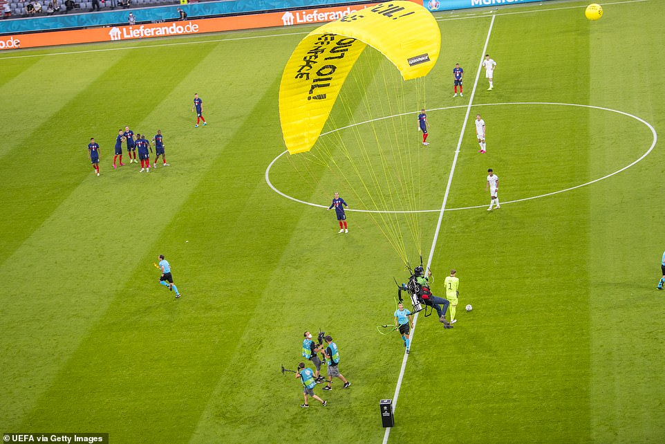 After nearly flying into the stands, putting fans at danger, he managed to divert his parachute and land on the pitch