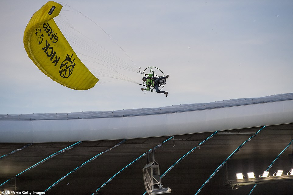 The parachutist came in at a steep angle and appeared to clip a cable when entering the stadium