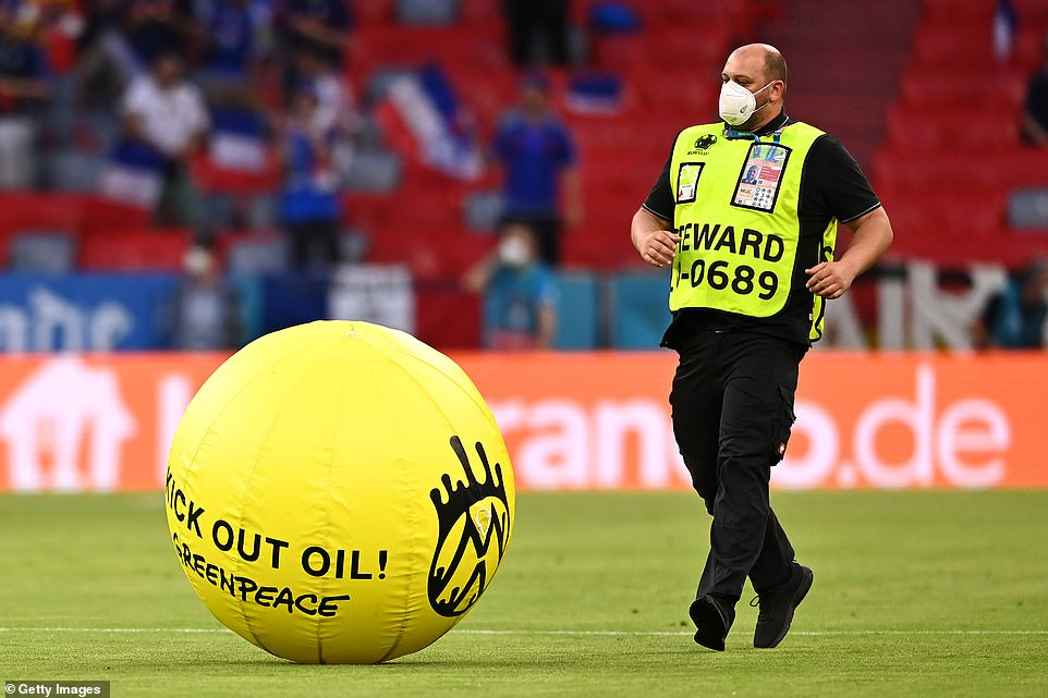 The Greenpeace paraglider dropped a ball with a 'kick out oil' slogan on it onto the pitch before hitting the spidercam wires