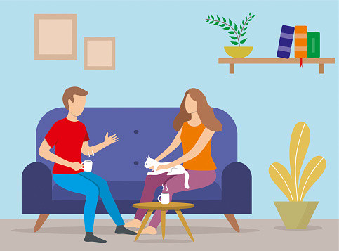 two people speaking at home
