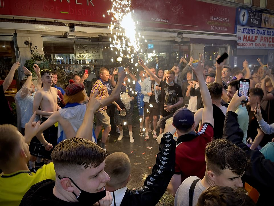 Scotland football supporters light flares in Leicester Square, central London, ahead of the Uefa clash
