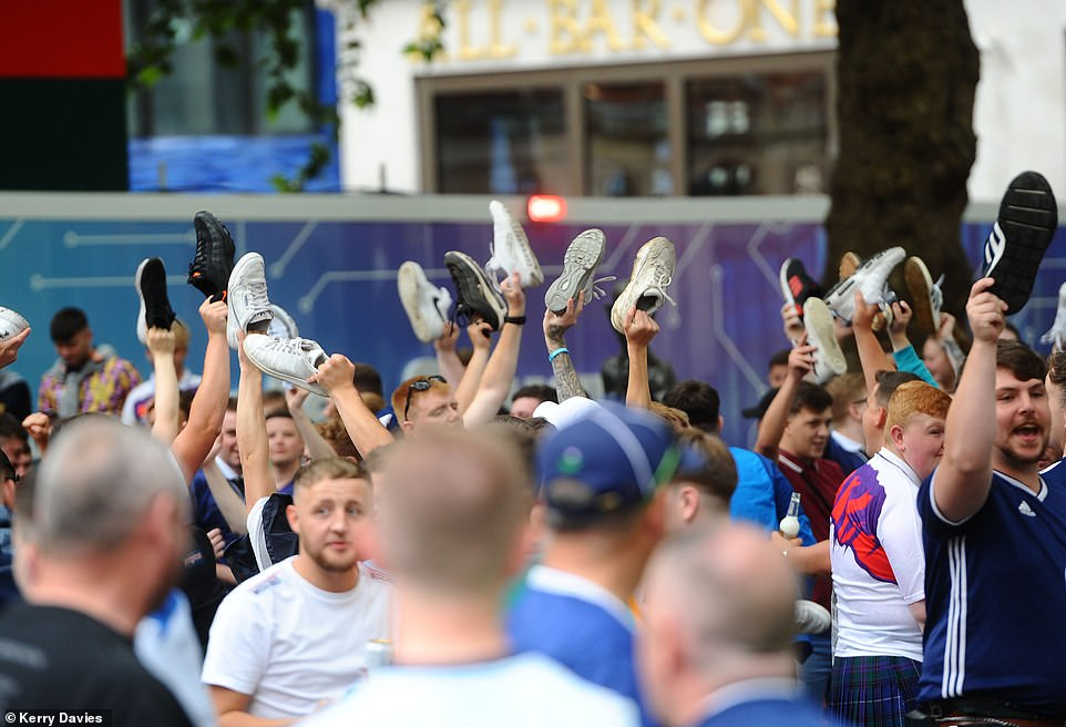 Scotland football fans are seen drinking and singing in Leicester Square ahead of the Euro 2020 clash