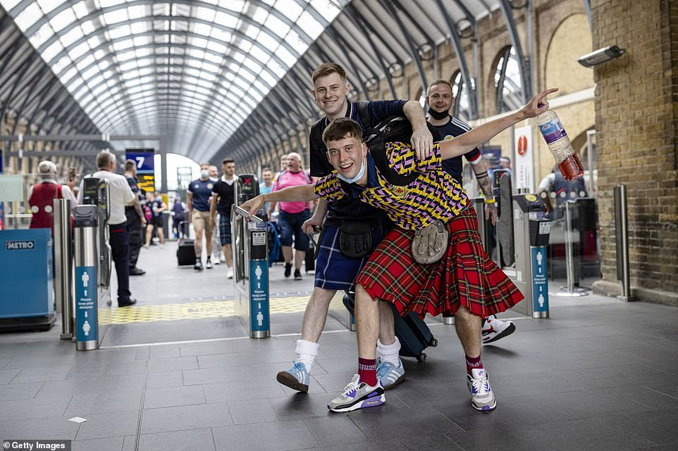 Scotland football fans wearing kilts arrive at King's Cross Station in central London ahead of the Uefa clash