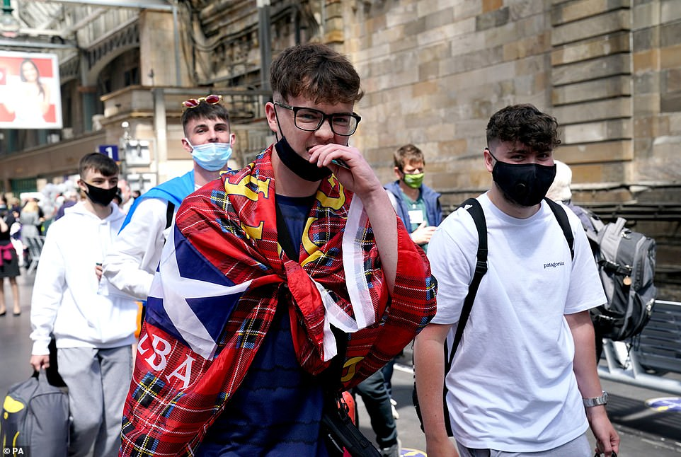 Scotland fans at Central station in Glasgow as they prepare to travel to London ahead of the UEFA Euro 2020 Group D match between England and Scotland at Wembley Stadium