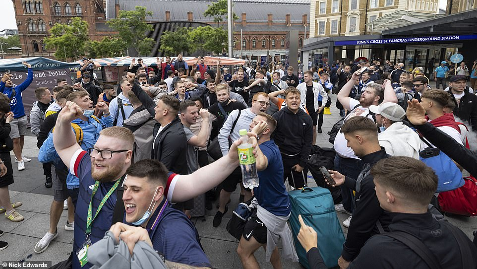 The police will work with stewards to stop ticketless fans accessing Wembley Way, and travelling fans in the England sections risk being ejected from the stadium. Pictured: Scotland fans in London