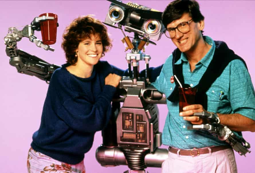 director John Badham, right, with Number 5 and human co-star Ally Sheedy.