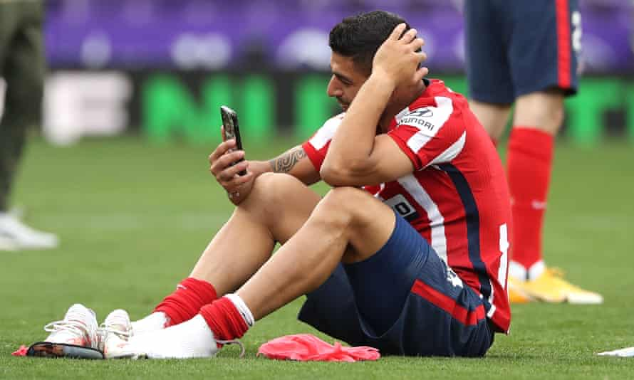 Luis Suárez speaks to his family on the phone after clinching the La Liga title with Atlético Madrid.