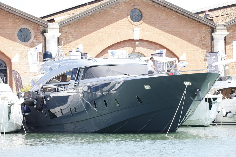 A navy-blue yacht on display at the 2021 Venice Boat Show.